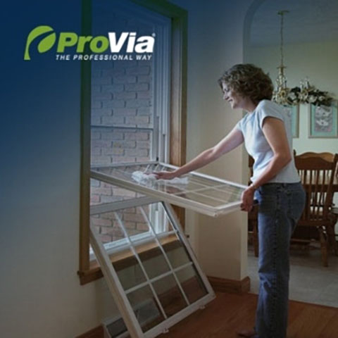 Lady cleaning Provia double hung